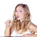 Blonde girl eating sushi — Stock Photo
