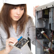 Brunette girl repairing the system unit — Stock Photo #28517293
