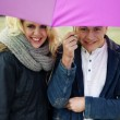 Young couple under an umbrella — Stock Photo #28517719