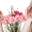Blonde girl with flowers — Stock Photo #28517743