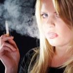 Blonde girl smokes a cigarette — Stock Photo #28517783