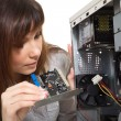 Brunette girl repairing the system unit — Stock Photo