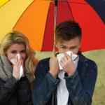 Young couple under an umbrella — Stock Photo #28517849