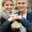 Couple with house model — Stock Photo