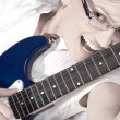 Blonde girl with electric guitar — Stock Photo