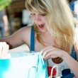 Blonde girl with shopping bags — Stockfoto