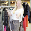 Blonde girl in boutique — Stockfoto #28519071
