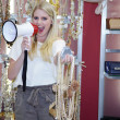 Saleswoman shouts in a megaphone — Stockfoto