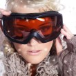 Woman in ski goggles isolated — Stock Photo #28519765