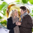 Stock Photo: Couple in winter clothes on a background of tea