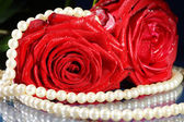 Rose with necklace — Stock Photo