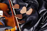 Violin on the bed — Stock Photo