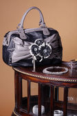 Bag with a necklace on the table — Stockfoto