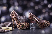 Shoes and handbag with spirits — Stock Photo