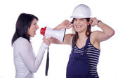 Girl shouts in a megaphone to architect — Stock Photo