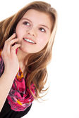Blond girl talking on mobile phone — Stock Photo