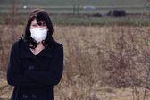 Ragazza bionda in una maschera — Foto Stock