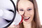 Blonde girl shouts in a megaphone — Stock Photo