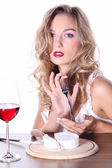Blonde girl having lunch with wine — Stock Photo