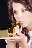 Menina morena com ouro — Foto Stock