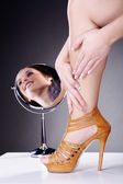 Foot girl on the background of her reflection in the mirror — Stock Photo