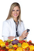 Woman doctor with fruits and vegetables — Stock Photo