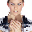 Portrait of a young pretty woman holding weights and doing fitness — Stock Photo