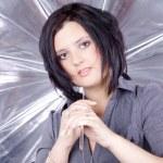 Brunette girl under the umbrella — Stock Photo #28521663
