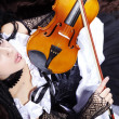 Young female violin artist — Stock Photo