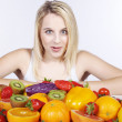 Blonde girl with fruit and vegetables — Stock Photo #28522095