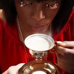 African girl drinking milk — Stock Photo