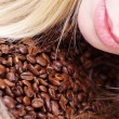 Girl with coffee beans — Stock Photo