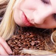 Stock Photo: Girl with coffee beans