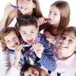 Group of children brushing their teeth — Stockfoto