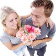 Young couple with bouquet of flowers — Stock Photo