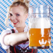 Young sexy woman wearing a dirndl with beer mug  — Stockfoto
