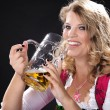 Young sexy woman wearing a dirndl with beer mug — Stock Photo