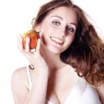 Brunette girl with apple — Stock Photo #28523989