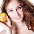 Brunette girl with apple — Stock Photo #28524223