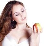 Brunette girl with apple — Stock Photo #28524721