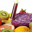 Different fruits and vegetables with syringe — Stock Photo