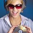Stock Photo: Womwith dj equipment