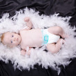 Baby in fur — Stock Photo