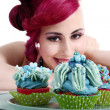 Stock Photo: Young smiling womwith cupcake