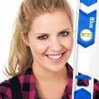 Blonde girl with a spirit level — Stock Photo