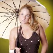 Blonde girl with an umbrella — Stock Photo