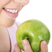 Blond woman eat green apple — Stock Photo