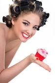 Young smiling woman with cupcake — Stock Photo