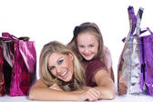 Mother and dauther with shopping bags — Stock Photo