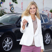 Blonde girl with keys — Stock Photo